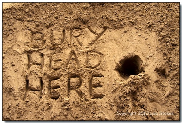 sand-bury-head-here